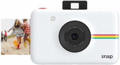 This is an image of a white instant camera by Polaroid for kids.