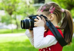 this is an image of a girl holding a camera