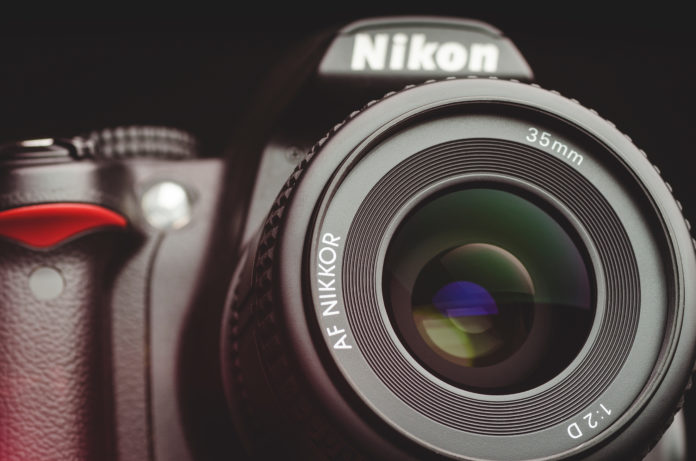this is an image of a nikon camera with 35mm lens