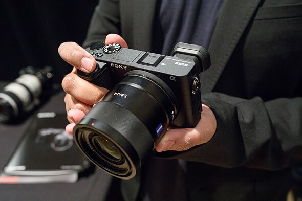 man holding a Sony a6500 digital camera