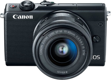 This is an image of a black Canon EOS M100 digital camera with 24.2 Megapixel cmos sensor, 15-45mm lens and 3.0-inch tilt-type LCD.