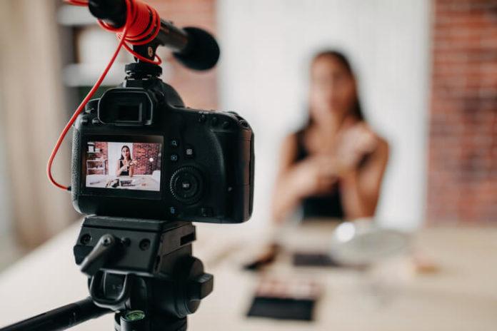 digital camera recording a woman