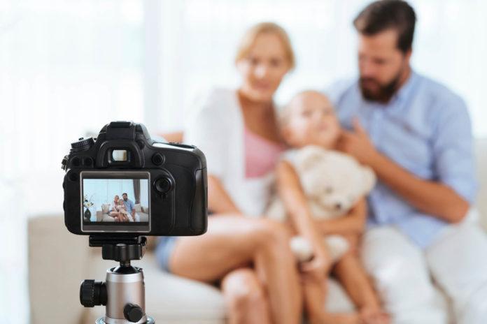 family using a Nikon camera to take a family portrait