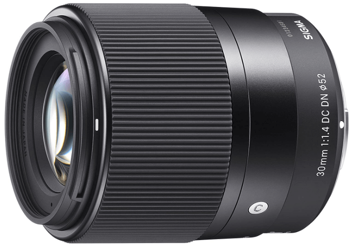 This is an image of a black Sigma 30mm camera lens for sony a6500 camera