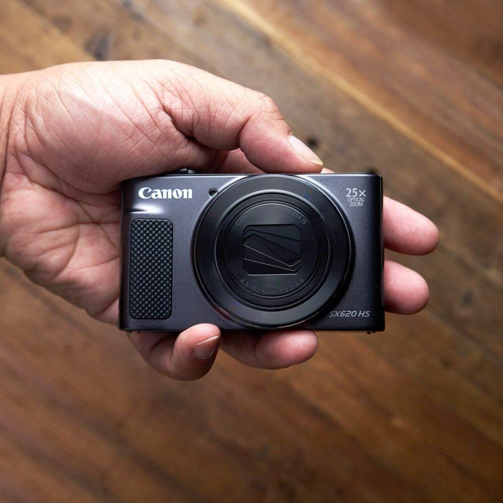 hand holding a Canon PowerShot SX620 camera