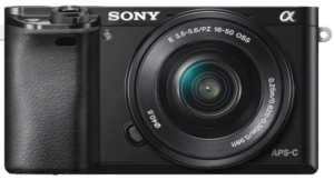 This is an image of a black Sony Alpha a6000 Mirrorless Digital Camera 24.3MP SLR Camera with 3.0-Inch LCD and w/16-50mm Power Zoom