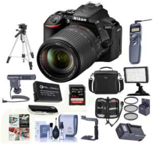 This is an image of a black Nikon D5600 DSLR Camera bundle Kit with AF-S DX NIKKOR 18-140mm VR Lens, Black - Bundle with Camera Case, 64GB SDXC Card, Video Light, Spare Battery, Tripod, Software Package, battery charger and Wireless remote
